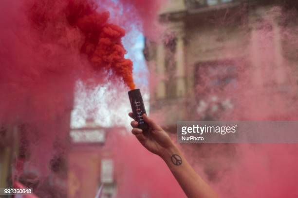 Detail of a red flare worn by a member of the PETA collective during his protest in the Plaza del Ayuntamiento in Pamplona on the occasion of the San...