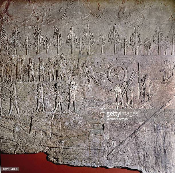 Detail of a relief depicting gangs of slaves hauling and levering a colossal stone bull mounted on a sledge during the building of Sennacheribs...