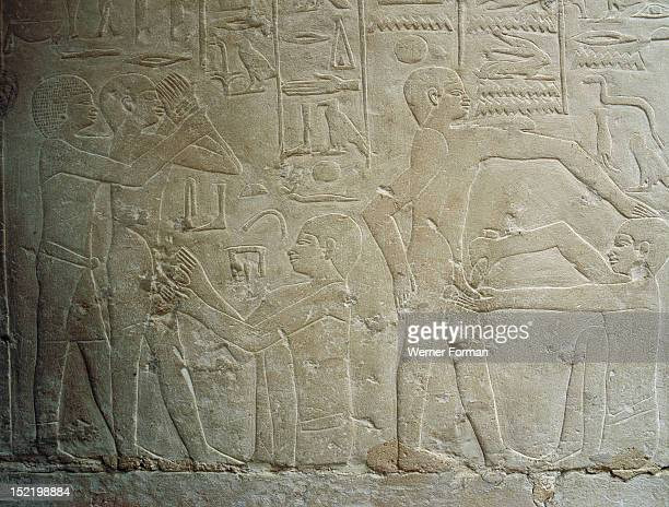 Detail of a relief in the tomb of Ankhmahor at Saqqara depicting a priest performing ritual circumcision on a young boy, Detail. Egypt. Ancient...