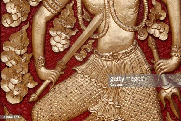 Detail of a relief on a door of Doi Suthep pagoda Chiang Mai Thailand