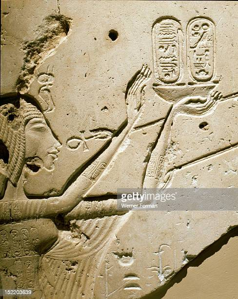 A detail of a relief showing Nefertiti worshipping the Aten One of Atens rays ends in a human hand that offers the queen the ankh symbol of life in...