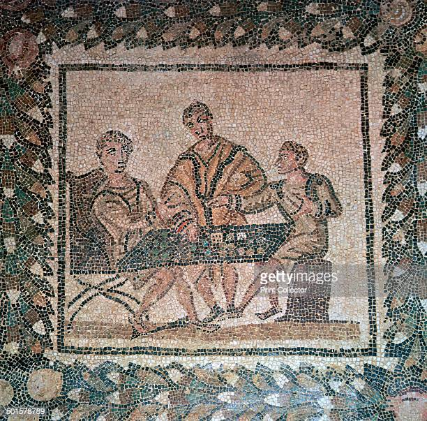 Detail of a Roman floor mosaic showing dice players from a dining room at El Jem Tunisia From the Bardo Museum's collection in Tunis 3rd century