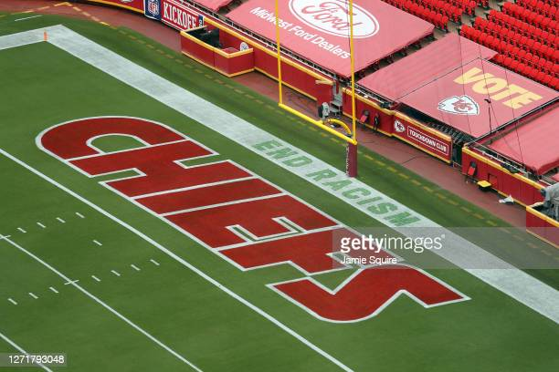A detail of a saying End Racism is seen painted in the end zone on one side of the stadium prior to the game between the Houston Texans and the...