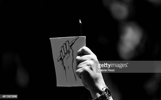 Detail of a sign during a tribute to the 17 victims of this week's Islamists militant attacks in France at Embassy of France on January 11, 2015 in...
