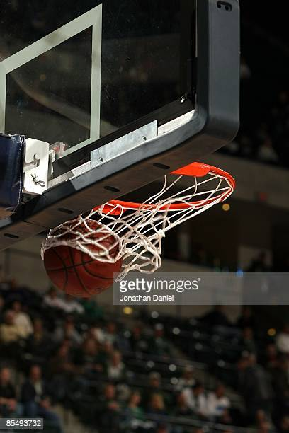 A detail of a spalding basketball going through the net as the Minnesota Golden Gophers play against the Northwestern Wildcats during the first round...
