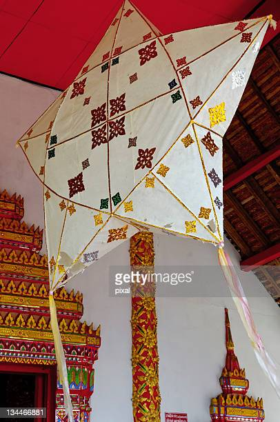 Detail of a star kite hanging at the entrance of a temple, Chiang Saen, Thailand, Asia