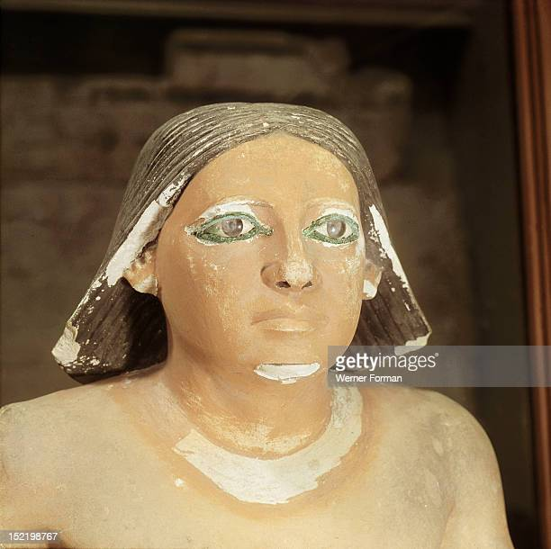 A detail of a statue of a seated scribe showing the head only Egypt Ancient Egyptian Old Kingdom 5th dync2494 2345BC Found at Saqqara