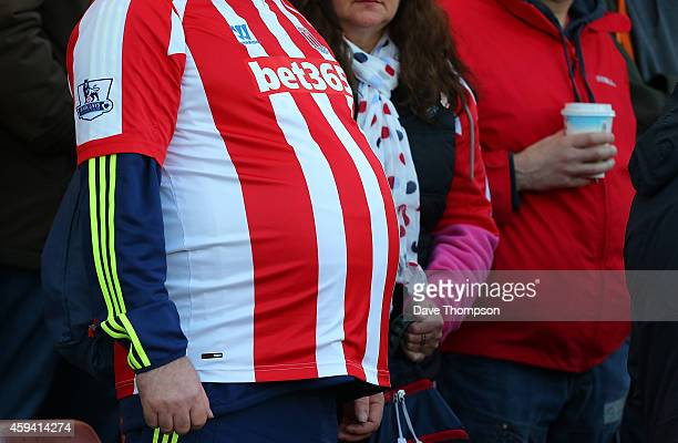 Detail of a Stoke City fan's belly during the Barclays Premier League match between Stoke City and Burnley at the Britannia Stadium on November 22...