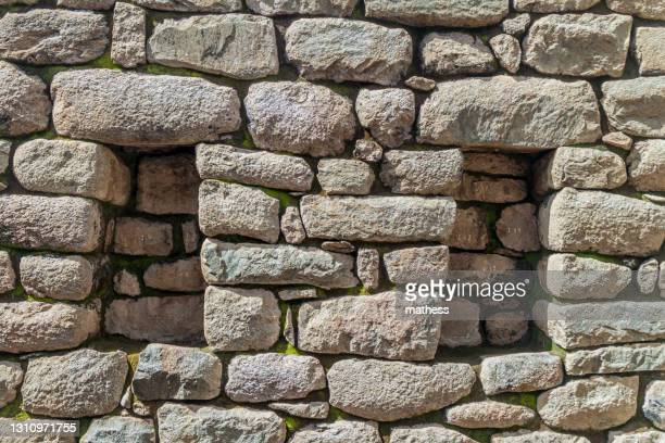 detail stone wall with niches at