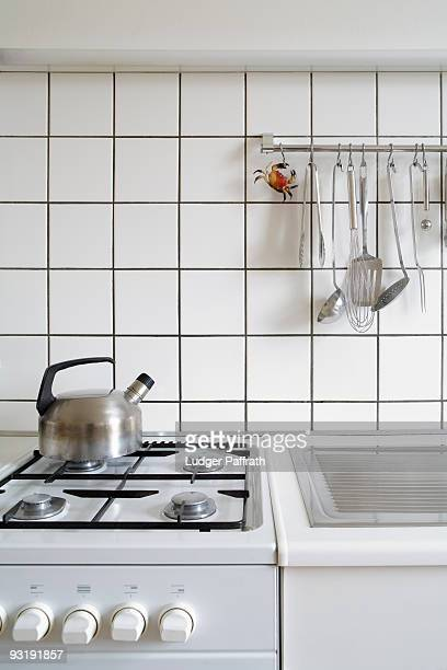 Detail of a stove and sink in a kitchen