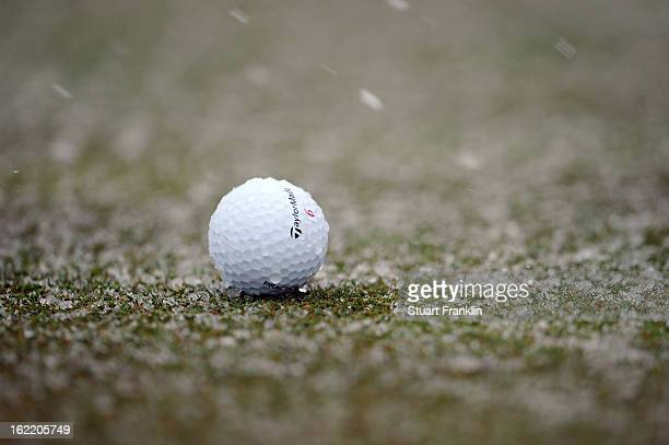 A detail of a Taylormade ball is seen on the course as snow falls which caused play to be suspended during the first round of the World Golf...