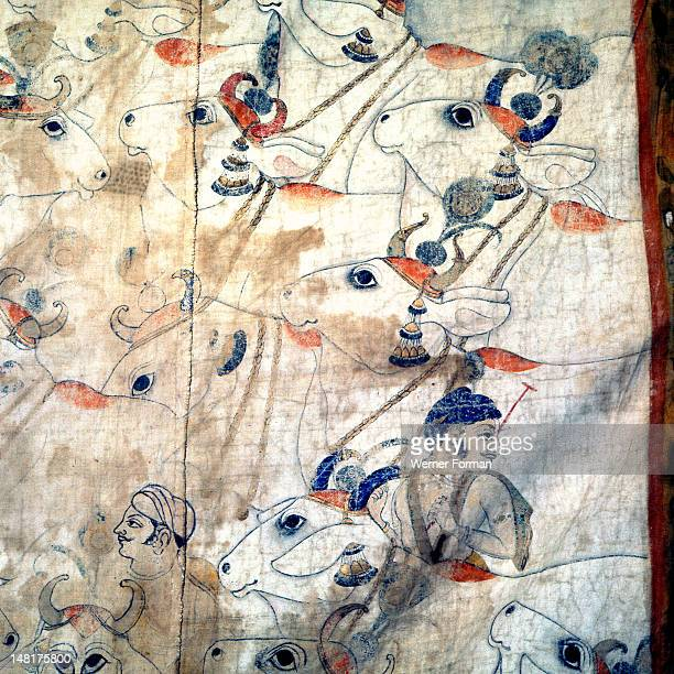Detail of a temple cloth in which Krishna plays his flute among the cows and herdsmen with whom he spent his youth Here we have a close up of the...