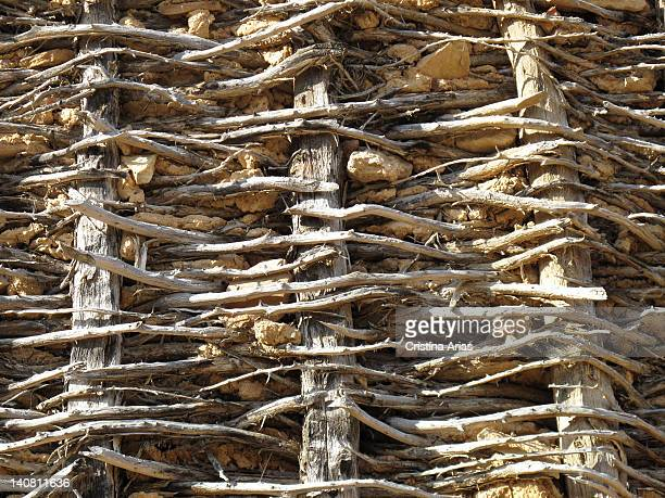 Detail of a traditional system to make fences using interlocking wood and mud filled with straw Calatanazor Soria Spain