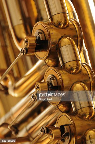detail of a tuba - air valve stock photos and pictures