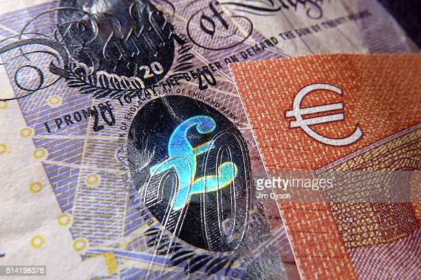 Detail of a twenty Pound bank note with with hologram design and a ten Euro note, on March 7, 2016 in London, England.