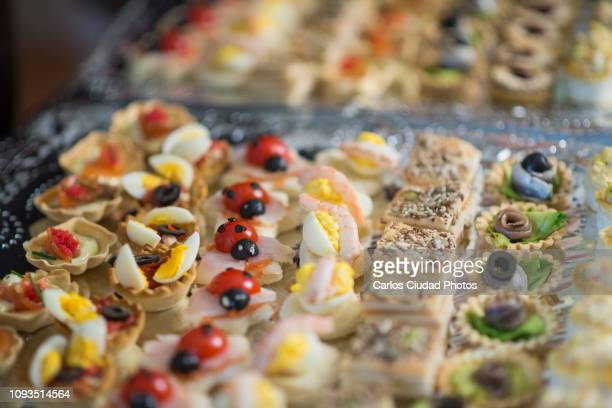 detail of a variety of cute and tasty canapes on a tray - christmas beetle stock pictures, royalty-free photos & images
