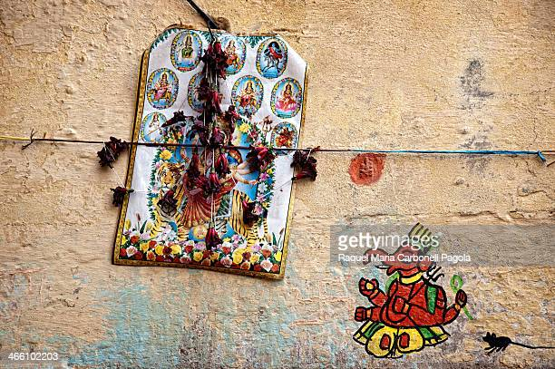 Detail of a wall decorated with images and paintings of Hinduism Gods