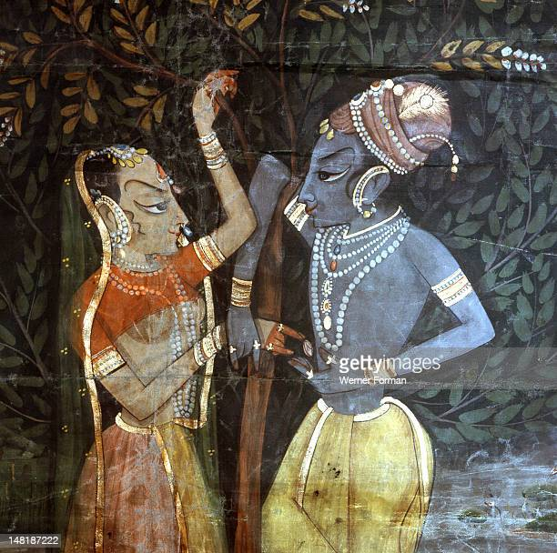A detail of a wall hanging with a scene from the legend of Krishna Here he talks with a gopi She could be Radha his favourite of the gopis India...