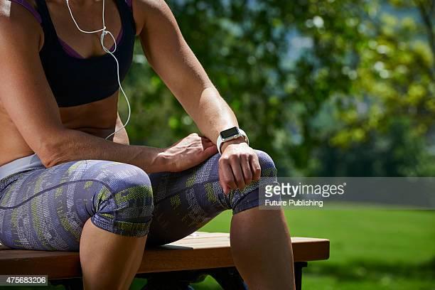 Detail of a woman in sportswear checking an Apple Watch Sport, taken on May 21, 2015.