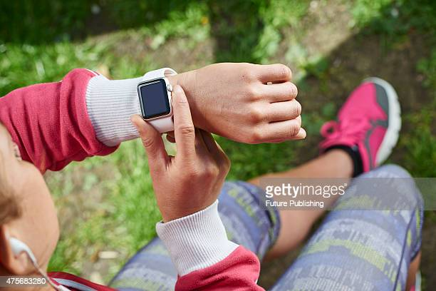 Detail of a woman in sportswear checking an Apple Watch Sport taken on May 21 2015