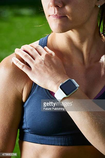 Detail of a woman in sportswear modelling an Apple Watch Sport taken on May 21 2015