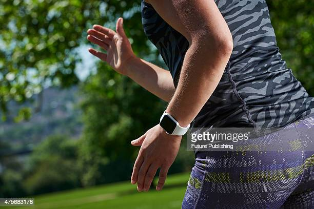 Detail of a woman in sportswear running while modelling an Apple Watch Sport taken on May 21 2015