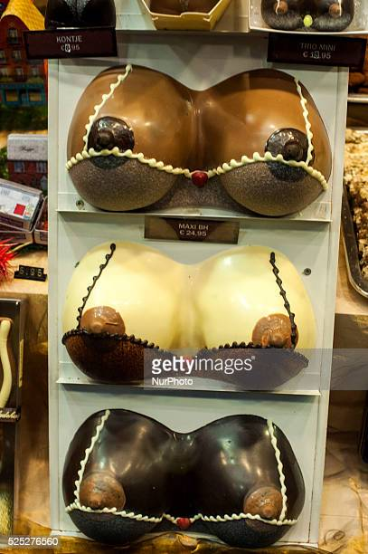 Detail of a woman's breasts of different types of chocolate in the window of a Chocolatier Bruges BRUGESBELGIUM The main attraction of Bruges is its...