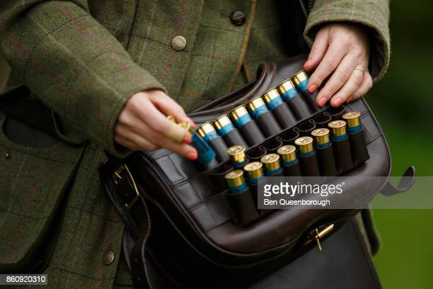 Detail of a woman's cartridge bag during a clay pigeon shoot