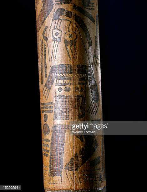 Detail of a wooden dance wand used by Nazca shamans in hypnotic trance dance ceremonies, Pyro engraved designs on the wands depict shamans in trance...