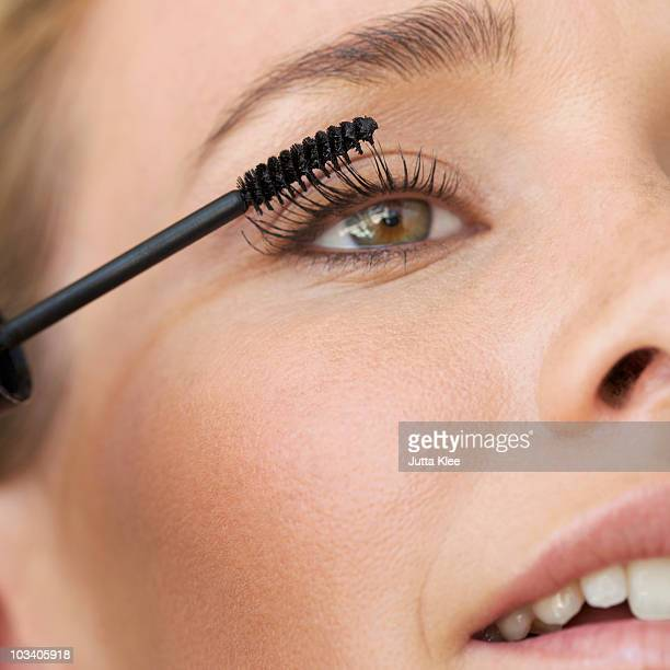 detail of a young woman applying mascara - mascara stock pictures, royalty-free photos & images