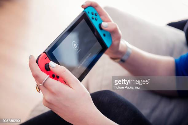 Detail of a young woman playing video games on a Nintendo Switch home console, taken on March 7, 2017.