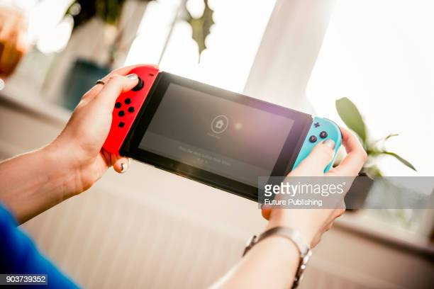 Detail of a young woman playing video games on a Nintendo Switch home console taken on March 7 2017