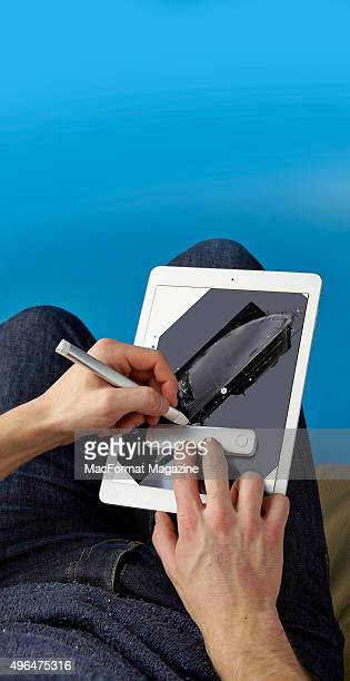 Detail of an Adobe Ink stylus and slide being used with an Apple iPad Mini taken on February 13 2015