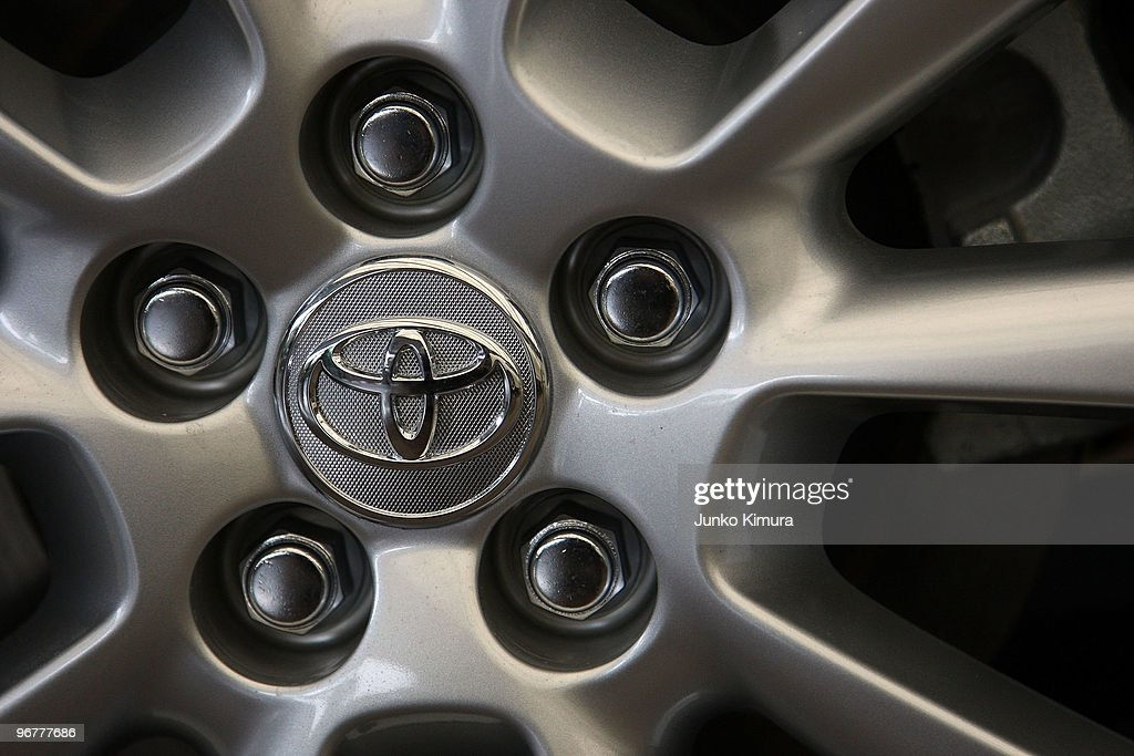 Detail of an alloy wheel with Toyota's logo on a car displayed at the company's Tokyo headquarters on February 17, 2010 in Tokyo, Japan. Toyota promised a brake-override system in all future models worldwide, also will set up third-party research organization to test its electronic throttle control system.