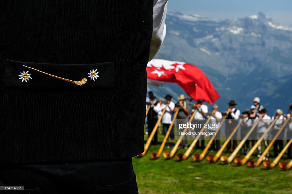 A detail of an alphorn player adorns a jacket as alphorn players perform on July 28, 2013 in Nendaz, Switzerland. About 150 alphorn blowers performed together on the last day of the international Alphorn Festival of Nendaz. The Swiss folkloric wooden wind instrument was used in most mountainous regions of Europe by mountain dwellers as signal instruments.