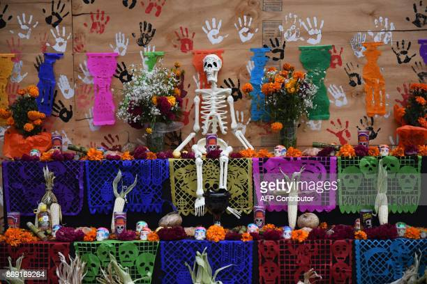 Detail of an altar in honour of the victims of Mexico's September 19 earthquake in front of a collapsed building at Tlalpan neighbourhood in Mexico...