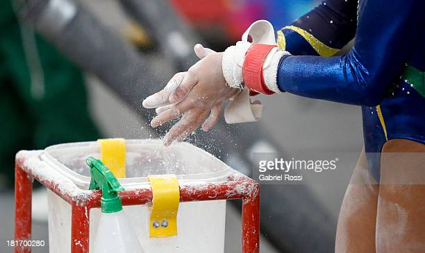 Detail of an athlete using magnesium prior to the Women's Team allaround as part of the I ODESUR South American Youth Games at Coliseo Miguel Grau on...