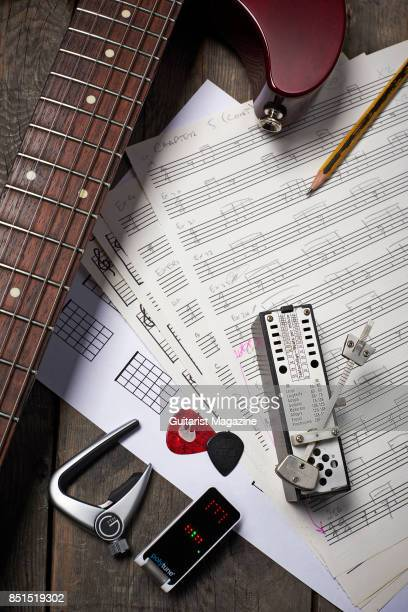 Detail of an electric guitar metronome G7th capo and sheet music photographed for a feature on writing music taken on September 20 2016