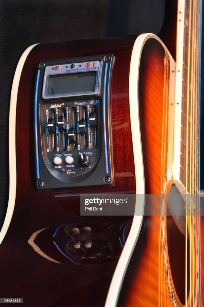 Detail of an electro acoustic guitar showing volume and EQ control panel, taken on 26th March 2010 in the United Kingdom.