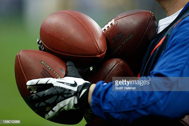 A detail of an official holding footballs as the Cincinnati Bengals play against the Houston Texans during their AFC Wild Card Playoff Game at...