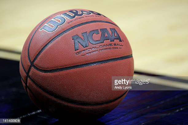 A detail of an official NCAA Men's Basketball game ball made by Wilson is seen on the court as the Iowa State Cyclones play against the Connecticut...