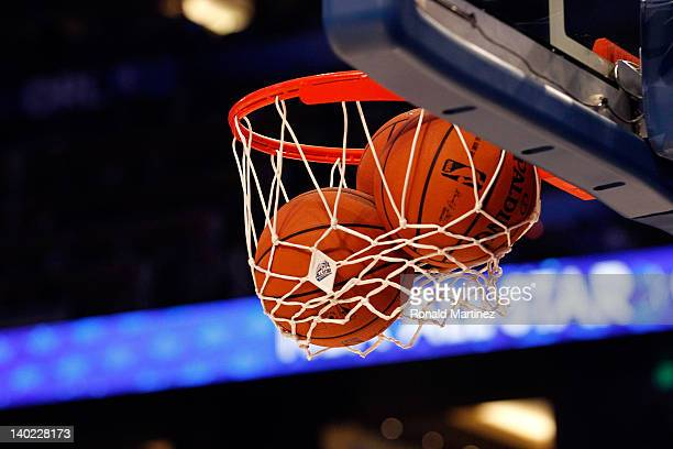 A detail of an official Spalding basketball going through the net with an offical logo of the 2012 Orlando NBA AllStar Game during the 2012 NBA...