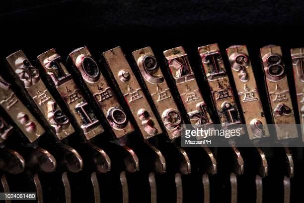 Detail of an old typewriter typebars
