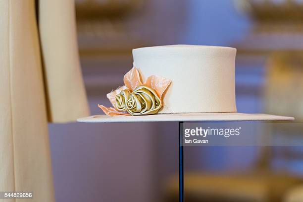 Detail of an outfit and hat designed by Angela Kelly worn by The Queen to the wedding of Prince William and Catherine Middleton at Westminster Abbey...