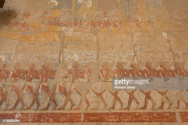 A detail of ancient Egyptian hieroglyphs showing Somalian slaves at the ancient Egyptian Temple of Hatshepsut near the Valley of the Kings Luxor Nile...
