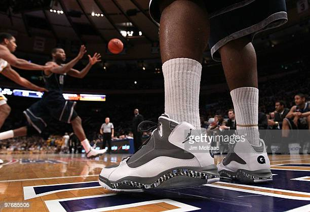 A detail of Austin Freeman of the Georgetown Hoyas sneakers are seen as he inbounds the ball during the championship of the 2010 NCAA Big East...