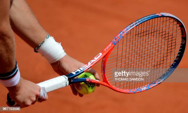 Detail of ball and racquet as Argentina's Diego Schwartzman prepares to serve to South Africa's Kevin Anderson during their men's singles fourth...