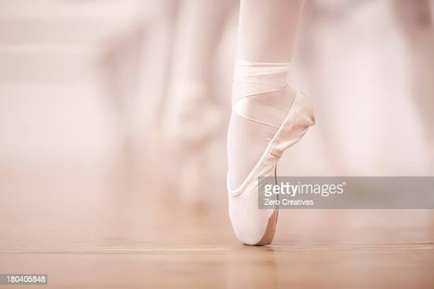 detail of ballerinas legs in dance studio - ballerina feet stock photos and pictures