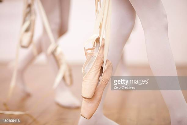 detail of ballerinas legs leaving dance studio - teen girls toes stock photos and pictures