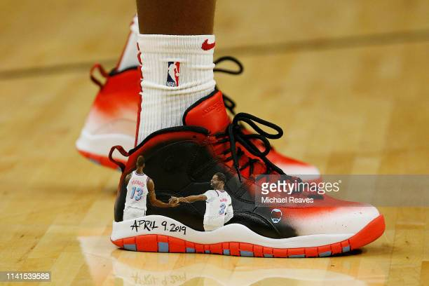 A detail of Bam Adebayo of the Miami Heat shoes honoring Dwyane Wade prior to Wade's final career regular season home game at American Airlines Arena...